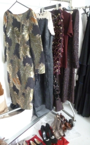 The fashion rail with (from left to right) dress by Gucci, dress by Bottega Veneta, skirt & top by Burberry Prorsum, dress by Prada.